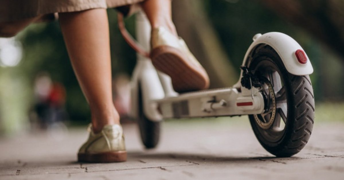 young-woman-riding-scooter-park-feet-close-up_1303-15755