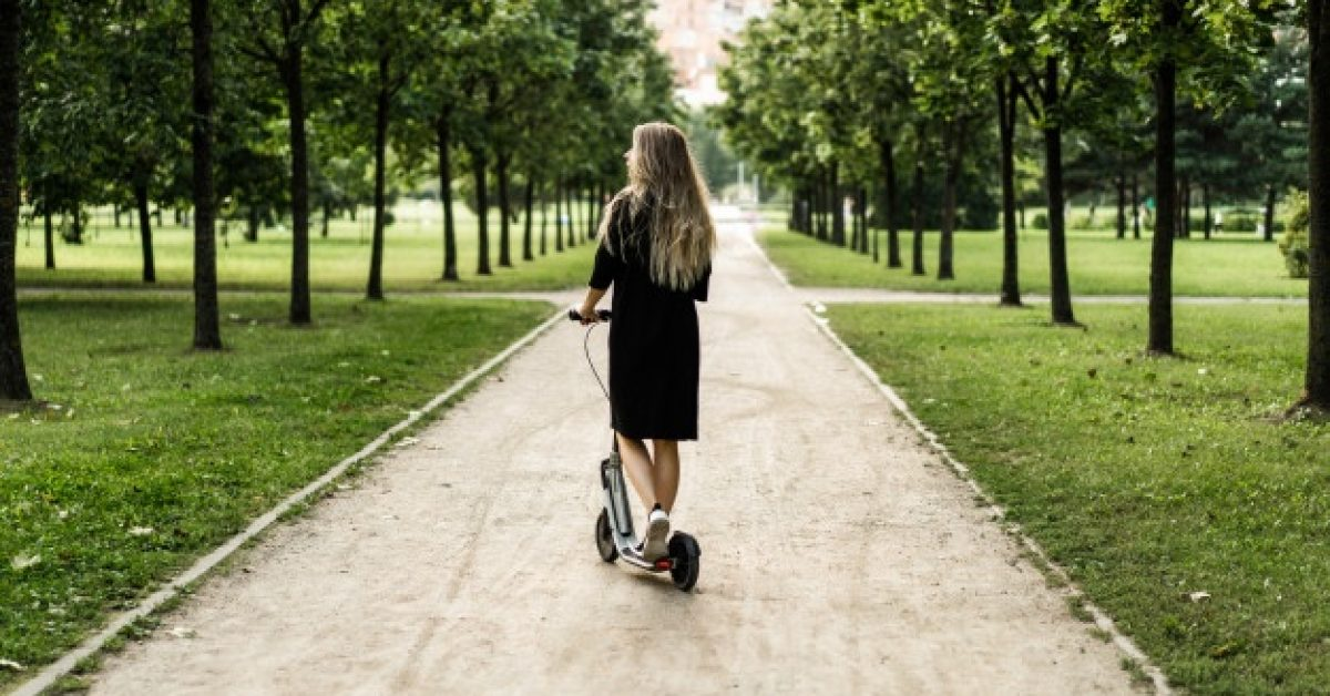 young-woman-with-long-hairs-electric-scooter-girl-electric-scooter_1321-1561