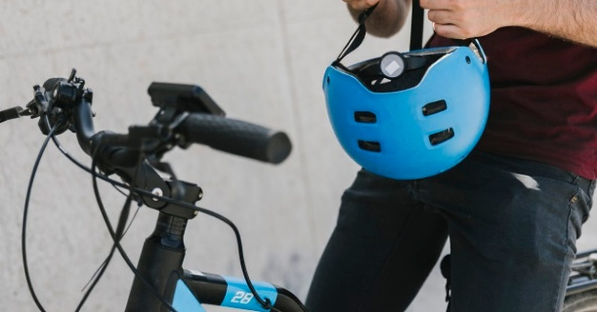 close-up-man-holding-helmet-bicycle_23-2148225869